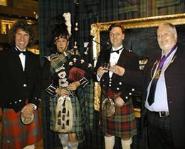The Lord Provost of Perth and Paul Ross, Director of 'The Macallan' with Charles Harris at the Exhibition in Hong Kong.