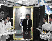 Charles awaits the guests at his Exhibition at The Landmark in Hong Kong with Silver Service Catering by Maxim's of Paris .