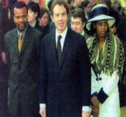 British Prime Minister Tony Blair accompanies King Mswati III of Swaziland and his wife Queen LaNgangaza in London.